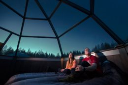 Waiting for northern lights inside an Arctic glass igloo in Rovaniemi in Lapland