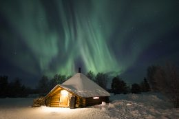 Northern lights and one of our Kota buildings here in Rovaniemi in Lapland